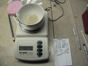 Sieving sand and weighing it to 3 decimal places