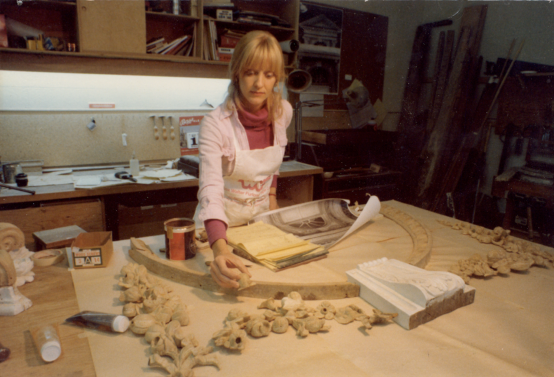 Cynthia Taylor is reassembling portions of the Hammond Harwood House front door woodwork in 1975 after the wood was consolidated with epoxy before paint removal to retain original carving.