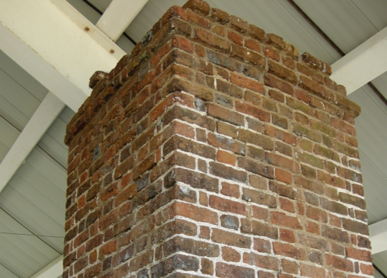 Repointing the cracks of the Menokin chimney with lime mortar after carbon fiber installation