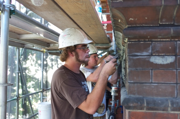 Repointing narrow curved terra joints in black mortar at the Sidney Yates Forestry Service Headquarters Building in Washington DC 2012.